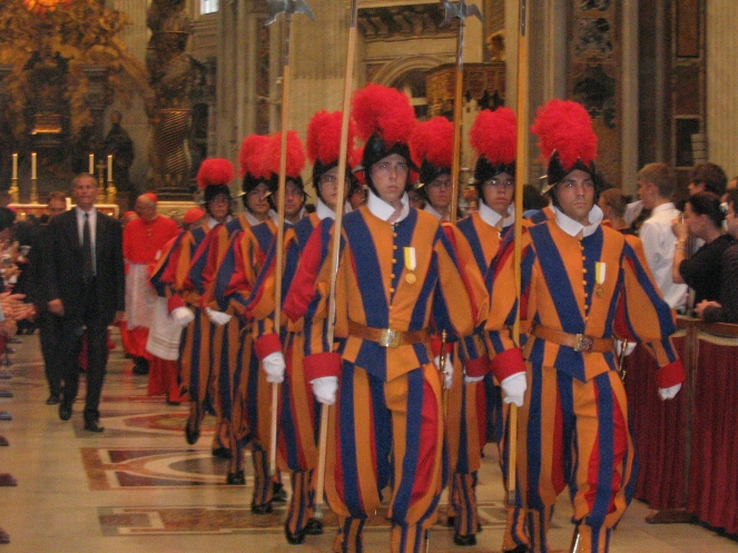 Group_of_swiss_guards_inside_saint_peter_dome.jpg
